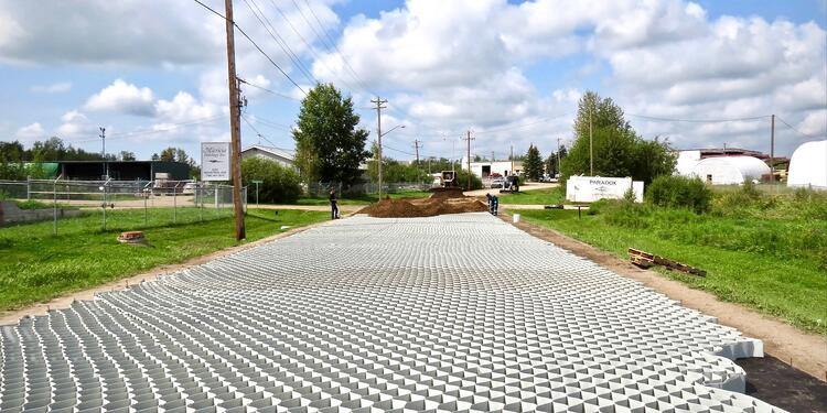 Municipal road under construction using Tough Cell geosynthetics.
